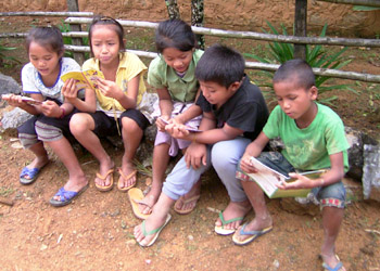 Kids reading in a Phou Khoun village
