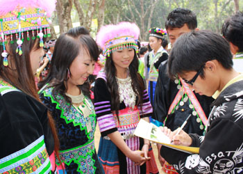 James talks with participants at the Hmong New Year festival.