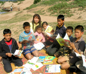 Setting up a home-based library in a Lao village.